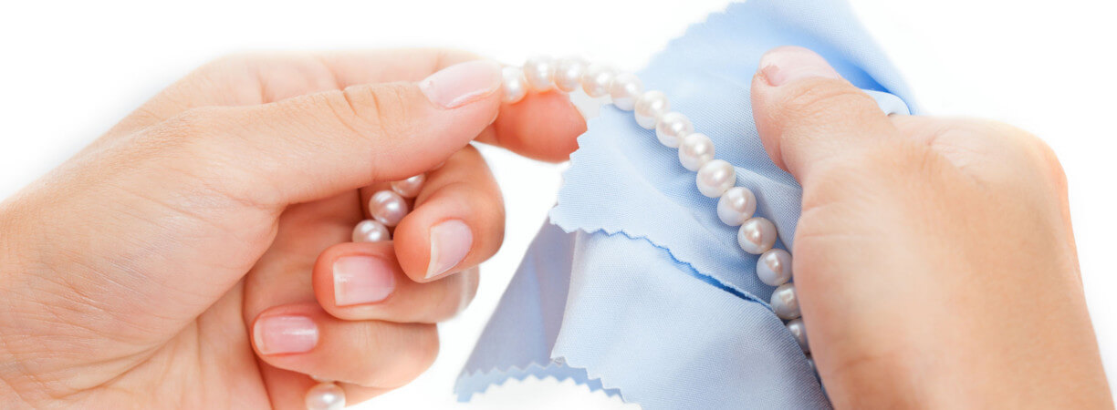 Cleaning Pearl Jewellery with a soft cloth